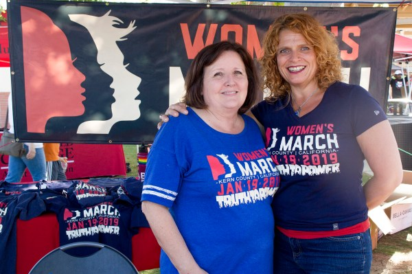two females at womens march 2019 booth