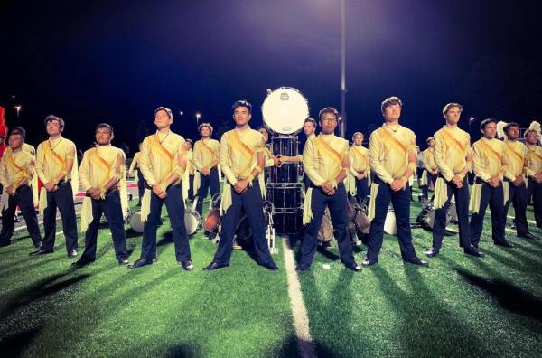 Drum corp standing at attention.