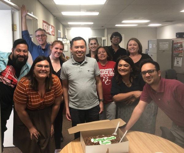 Staff in A17 gather around for birthday cake