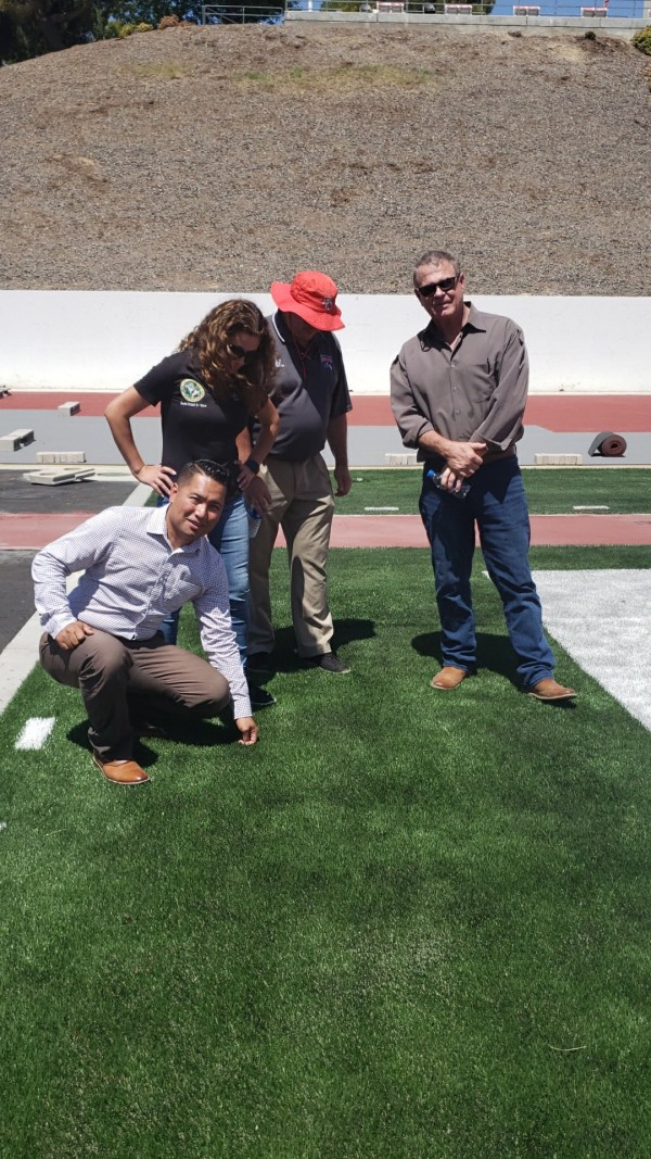 inspecting the astroturf.