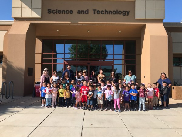 Children and parents/teachers in front of Science and Technology Building.