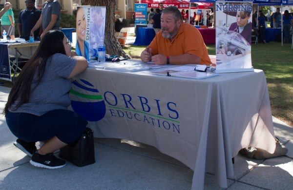 Orbis Education rep speaking to student.