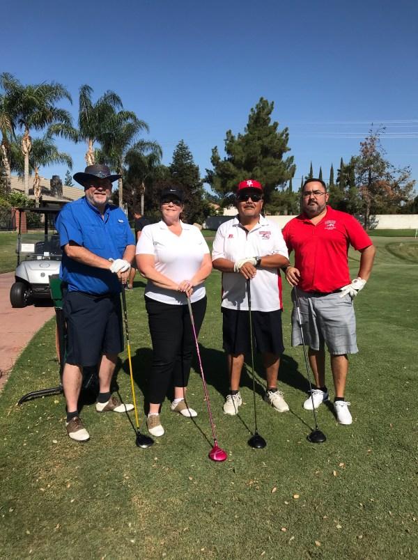 Four golfers.