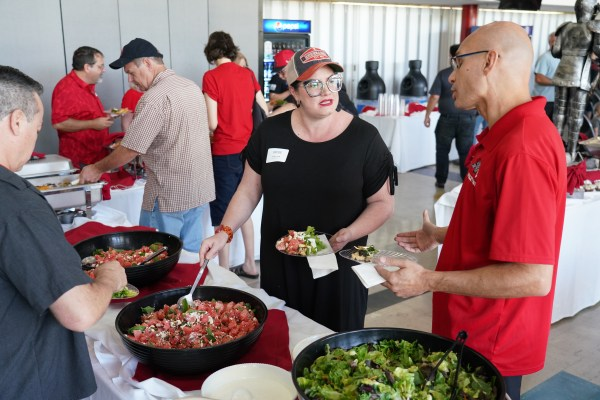 Faculty serving from bowl.