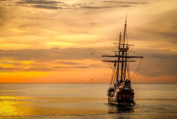 Ship sailing into horizon