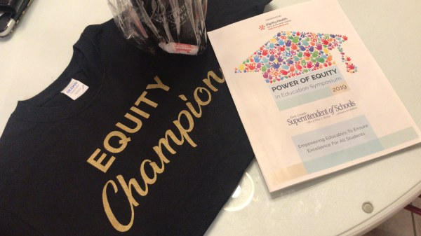 Equity Champion T-shirt and brochure.