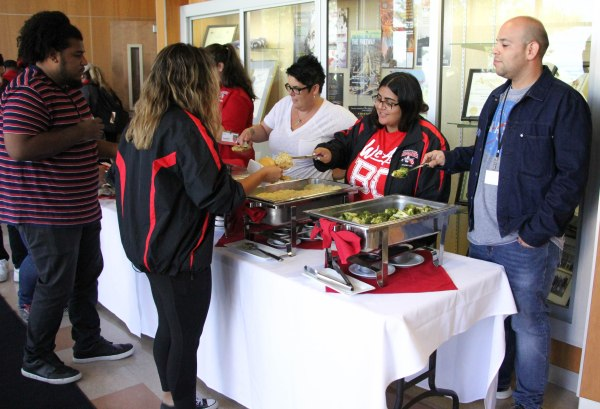 Staff and BCSGA members serving lunch to the students.