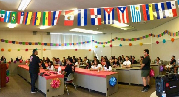 Room decorated with flags from different latin countries.