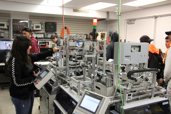 Students viewing a demonstration in an automation lab.