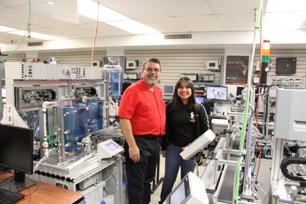 Faculty and student in the automation lab.