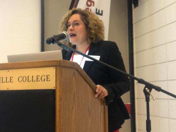 Speaking at podium.