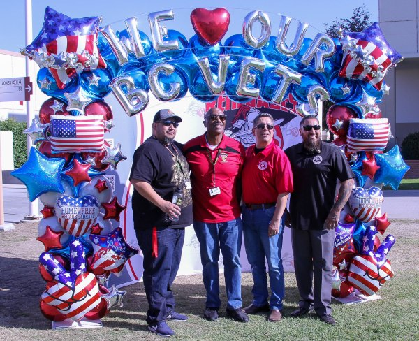 In the photo booth with balloons We heart our BC Vets.