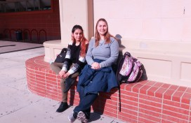 Two students hanging out in front of CSS.
