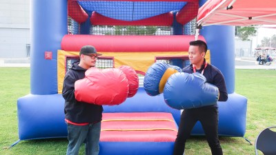 2 students with giant boxing gloves.