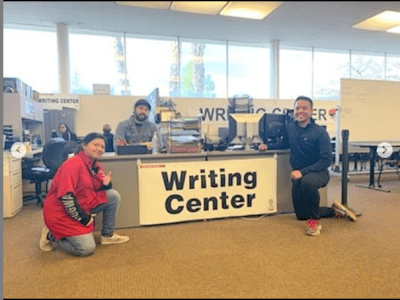Students with staff memeber in Writing Center.