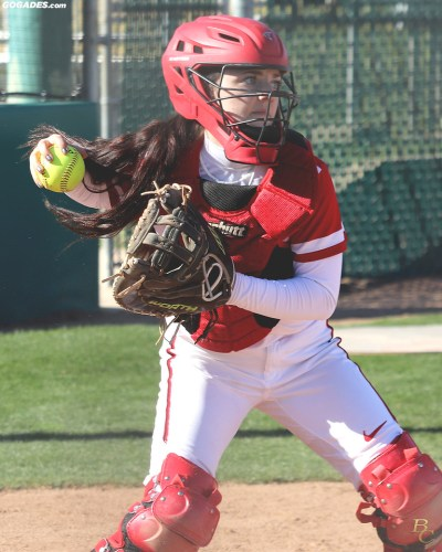 A Renegade softball catcher gets ready to throw the ball to first.