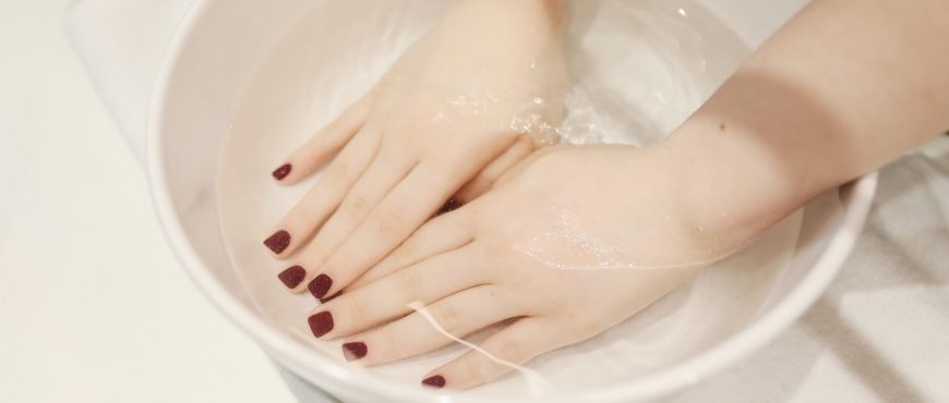 photo-of-person-s-hand-soak-in-water-3738378