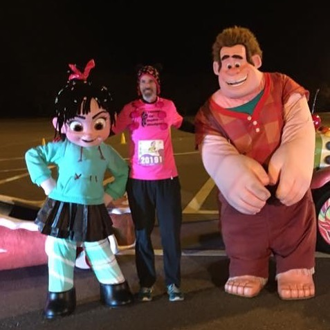 [image: Early morning, Venelope from Disney's Wreck it Ralph stands with Jack Lillard and Wreck it Ralph for a picture during the Disney Princess Races]