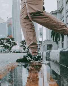 person stepping on a puddle