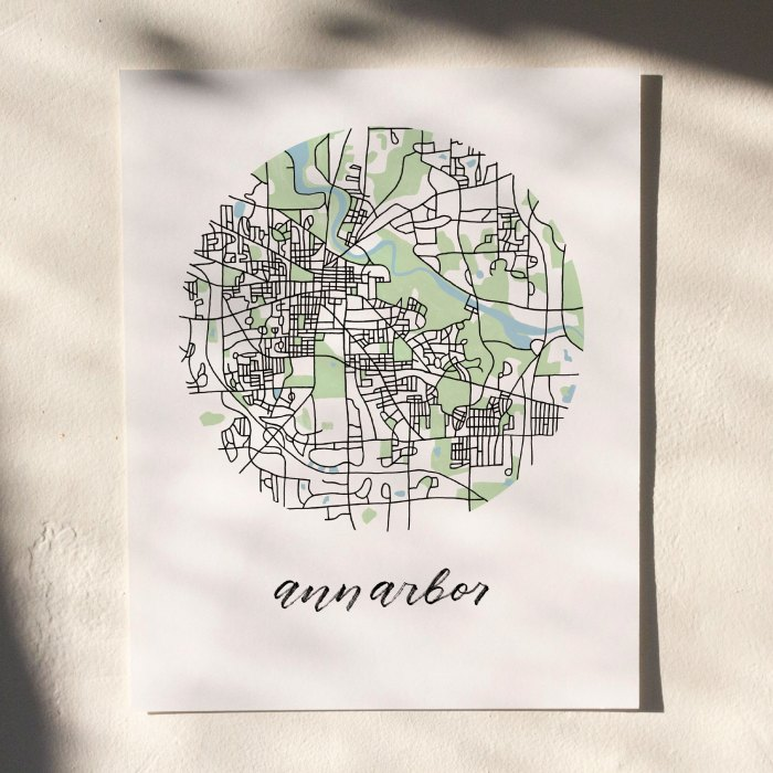 Ann Arbor Map Print hanging on white wall with leaf shadows across the image