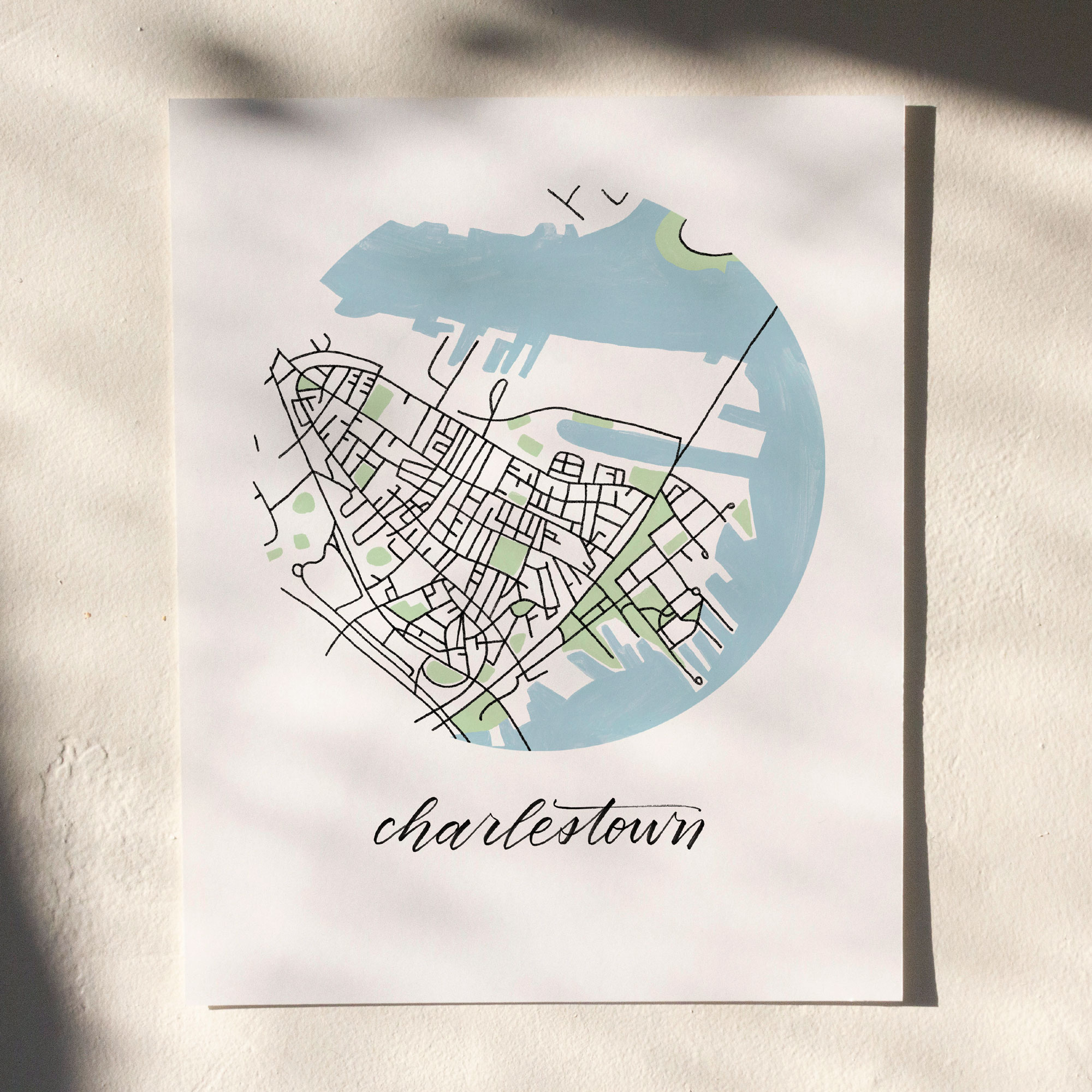 Charlestown, Boston Map Print hanging on white wall with leaf shadows across the image
