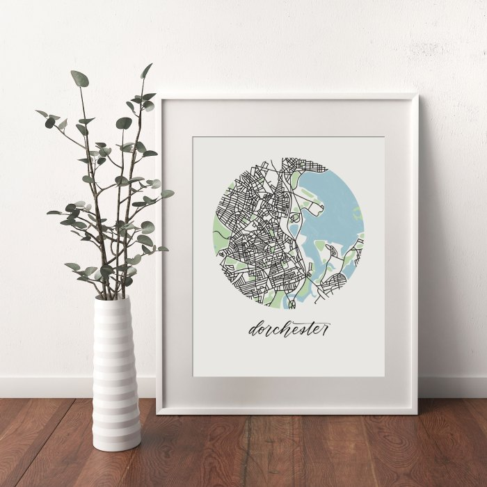 Dorchester, Boston Map print framed and leaning on white wall next to dried leaves in a vase