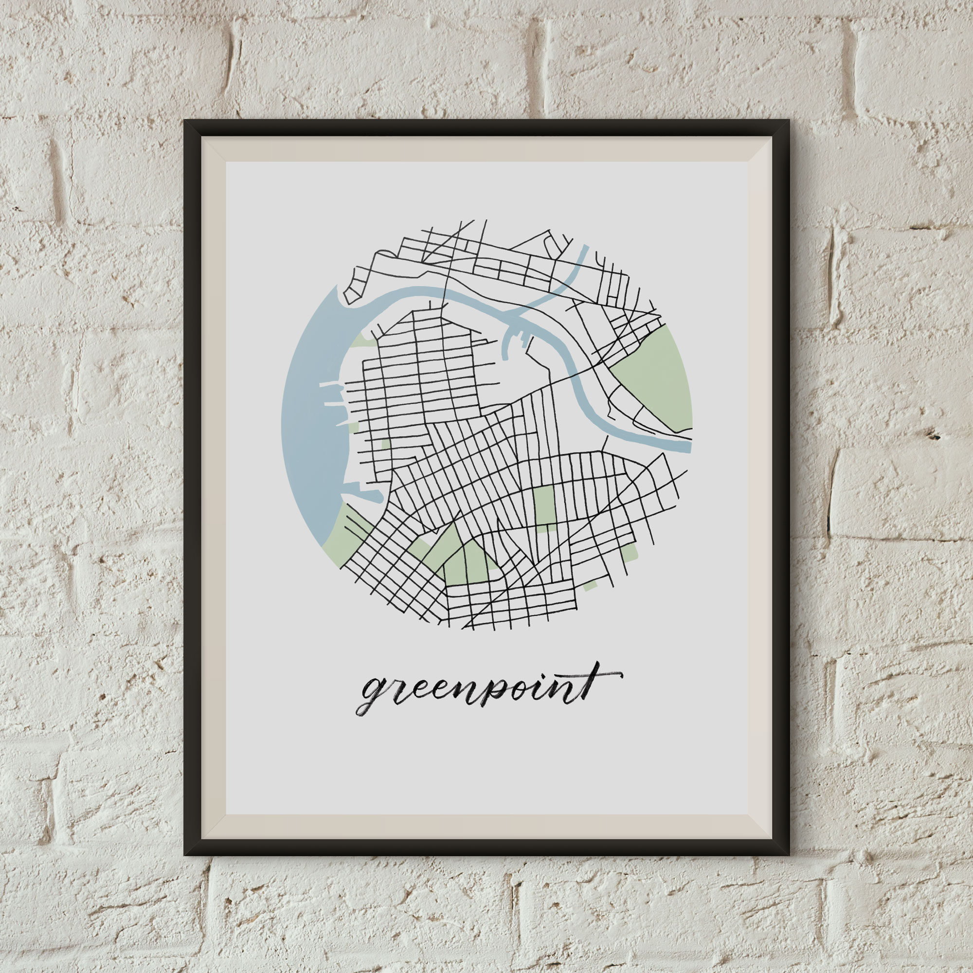 Greenpoint Map Print framed on a white brick wall