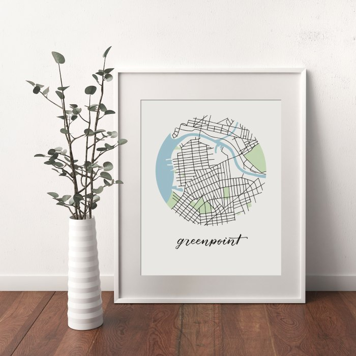 Greenpoint, Brooklyn Map print framed and leaning on white wall next to dried leaves in a vase
