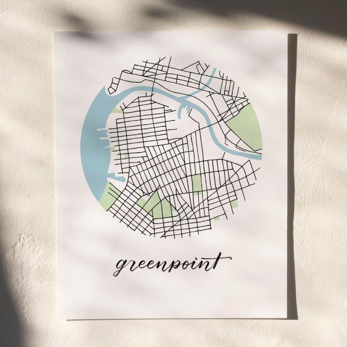 Greenpoint, Brooklyn Map Print hanging on white wall with leaf shadows across the image
