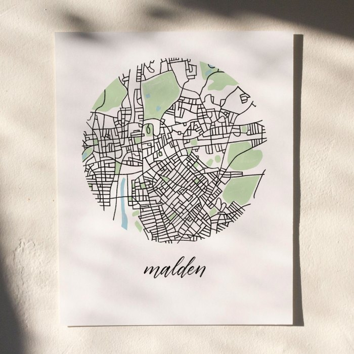 Malden, Boston Map Print hanging on white wall with leaf shadows across the image