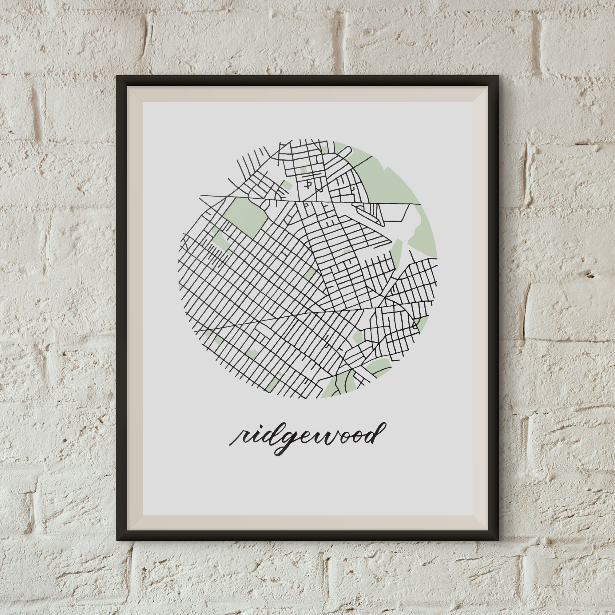 Ridgewood, Queens Map Print framed on a white brick wall