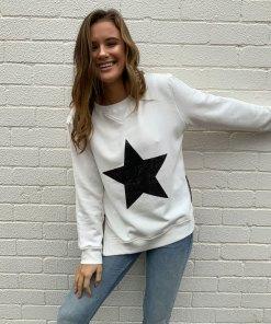 white sweater black star