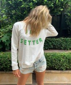 white jet setter sweater