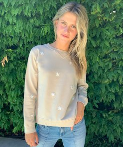 tan sweater with white star