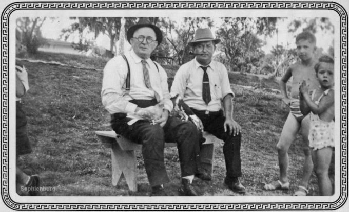"Men in Landa Park, 1939. One pigeon identified as ""Blue Bird."" Sophienburg Museum and Archives"