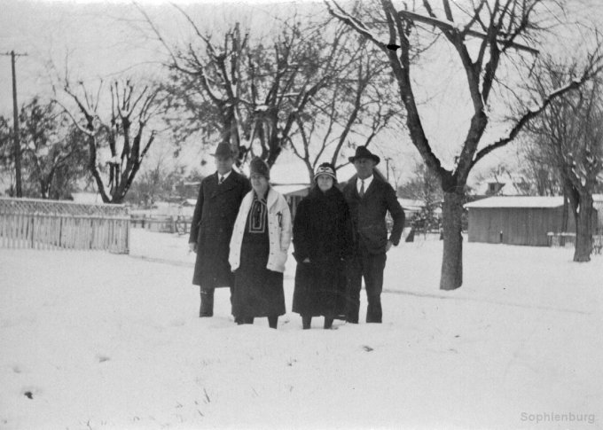 Couples up to their ankles in snow, 1926. (0588A)