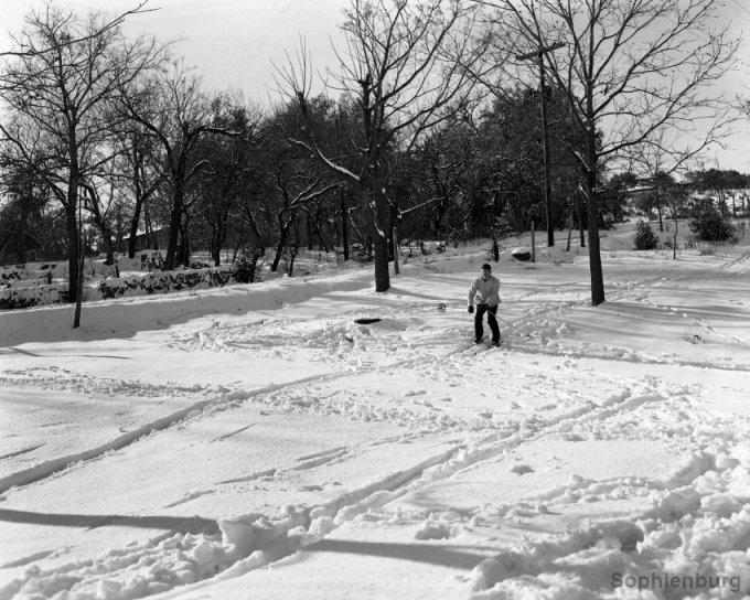 E.O. Krause skiing down Klappenbach Hill (Fredericksburg Road at Landa Park), 1949. (S491-100)