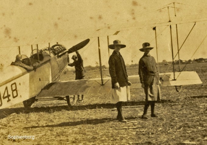 Photo: P1007-94B – Two women and a biplane at an unknown local field, c1920s. Sophienburg Collection.