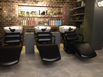 Recline in comfort. The salon uses Redken & Pureology products