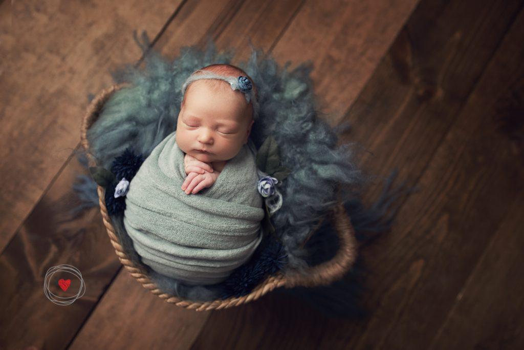 Newborn mini session sea green wrap and fluffy layer in basket