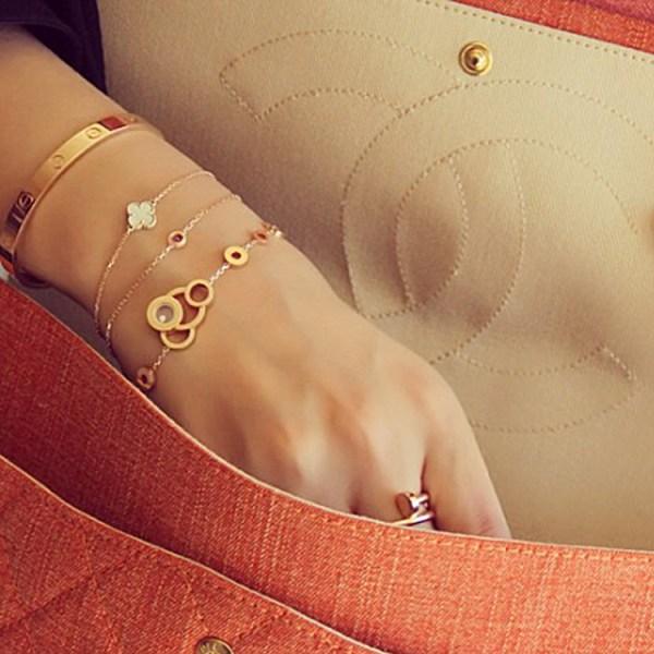 Latifa Al Shamsi's Van Cleep & Arpels Al Hambra Bracelet and Cartier Love Bracelet