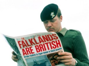 Soldier reads newspaper on Falklands War