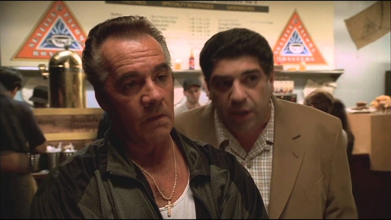 Paulie and Pussy ordering coffee at the coffee shop.
