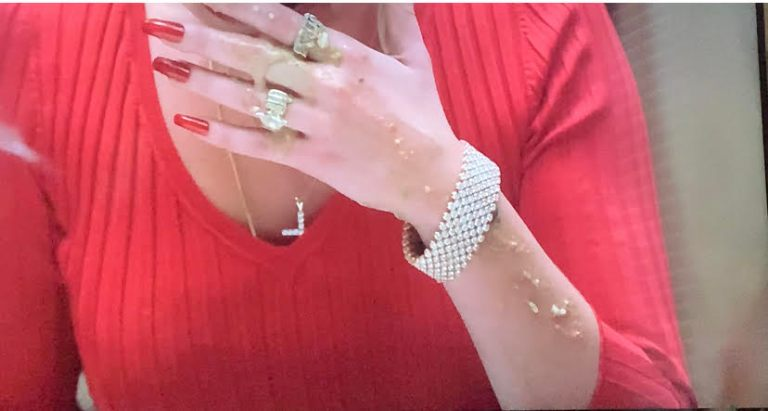 adriana just threw up and there is vomit on her arm and her jewelry.