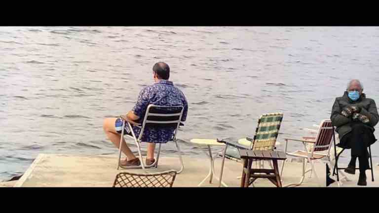 Tony Soprano sitting in a chair on the lake with a Bernie meme on the right side