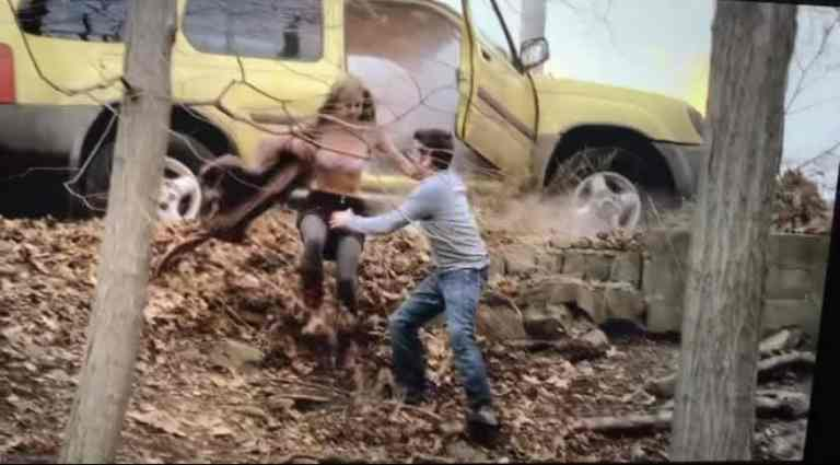 A.J. Soprano and his girlfriend are running out of his SUV before it explodes.