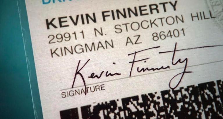 An identification card with the name kevin finnerty on it.