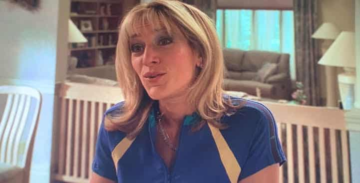 carmela soprano is talking to tony at home in their kitchen.