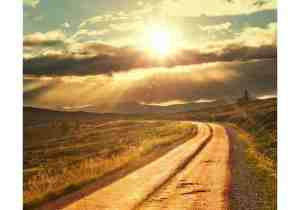 A road leading to a sunrise