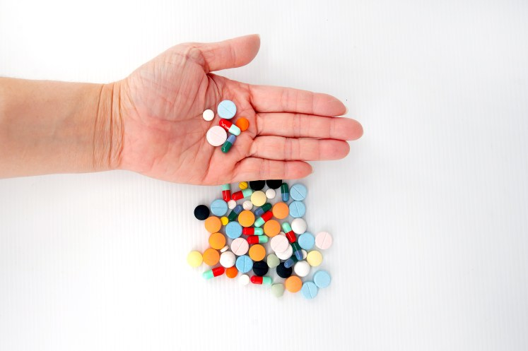 picture of hand and colorful pills
